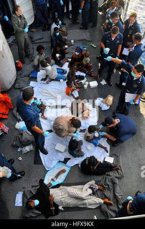 090524-N-4774B-220  GULF OF ADEN (May 24, 2009) Somali migrants, including a nine-month pregnant female, are treated - Stock Photo
