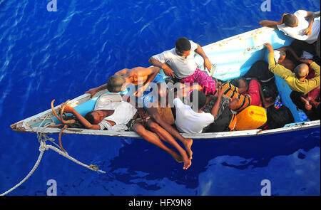 090525-N-4774B-032  GULF OF ADEN (May 24, 2009) Somali migrants in a disabled skiff wait for assistance from Sailors - Stock Photo