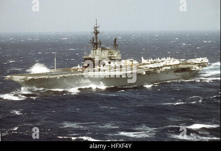 A port bow view of the aircraft carrier USS MIDWAY (CV-41) underway in rough seas. USS Midway (CV-41) in rough seas - Stock Photo