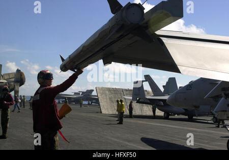 051021-N-0361G-020 Pacific Ocean (Oct. 21, 2005) - Aviation Ordnanceman Airman Clayton Hill checks an AIM-9X Sidewinder - Stock Photo