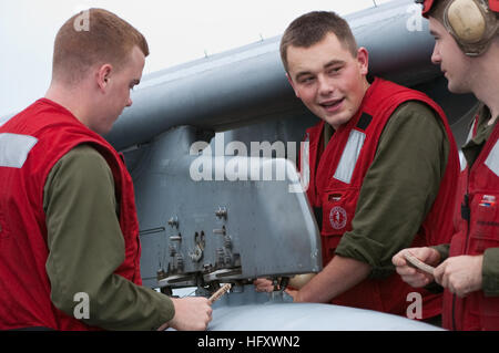 091028-N-5319A-247 ATLANTIC OCEAN (Oct. 28, 2009) Marine air crewmen work on an AV-8 Harrier aboard the amphibious - Stock Photo