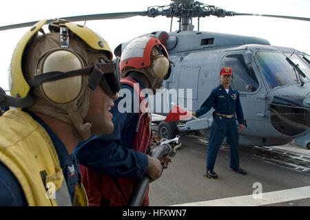 091028-N-9123L-013  SOUTH CHINA SEA (Oct. 28, 2009) Boatswain's Mate 3rd Class Eddis Ramirez, from New York, calls - Stock Photo