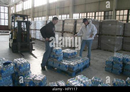 100127-N-9402B-001 JACKSONVILLE, Fla. (Jan. 27, 2010) Dmitriy Kokhanevich, left, and Mark Lane of URS Corporation - Stock Photo