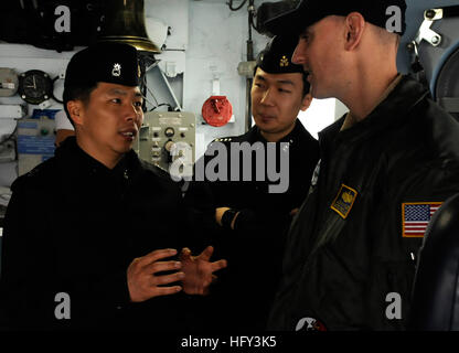 100310-N-9094S-321 BUSAN, Republic of Korea (March 10, 2010) Lt. Cmdr. Nathan Fugate talks about Navy life with - Stock Photo