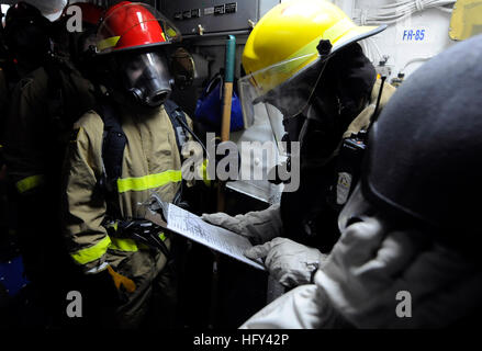 100318-N-7280V-321 BUSAN, Republic of Korea (March 18, 2010) Damage Controlman 2nd Class William Julian dispatches - Stock Photo