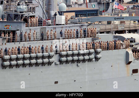 100518-N-7948R-115 SAN DIEGO (May 18, 2010) Sailors and Marines man the rails as the amphibious transport dock ship - Stock Photo