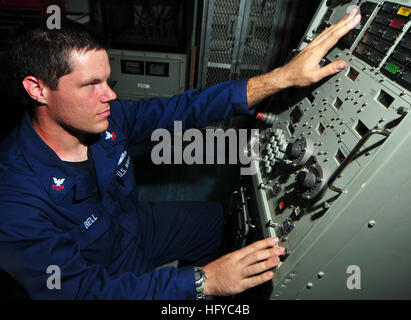 100817-N-7948R-199 ARABIAN GULF (Aug. 17, 2010) Fire Controlman 2nd Class Geoffrey Bell uses a local control panel - Stock Photo
