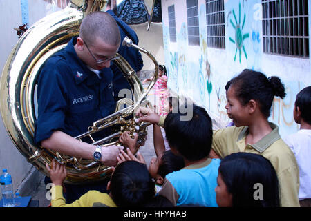 101204-N-1375V-193 SIHANOUKVILLE, Cambodia (Dec. 4, 2010) Musician 3rd Class Zachary Buckwash shows a sousaphone - Stock Photo