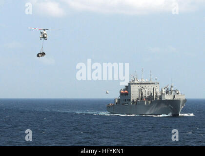 110215-N-5538K-050 GULF OF THAILAND (Feb. 15, 2011) An SA-330J Puma helicopter moves cargo from the Military Sealift - Stock Photo