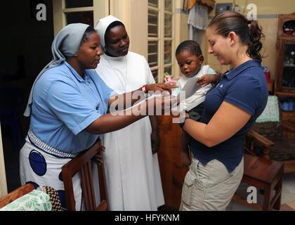 110216-N-6984M-001 TANGA, Tanzania (Feb. 16, 2011) Hospital Corpsman 2nd Class Cheryl Parker shows photographs of - Stock Photo