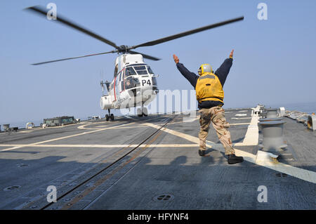 110330-N-3954O-045 PACIFIC OCEAN (March 30, 2011) An SA-330J Puma helicopter lands aboard the guided-missile destroyer - Stock Photo