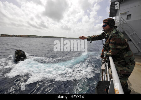 110628-N-YO394-077 CURACAO, Netherlands Antilles (June 28, 2011) A Royal Netherlands Marine directs Sailors assigned - Stock Photo