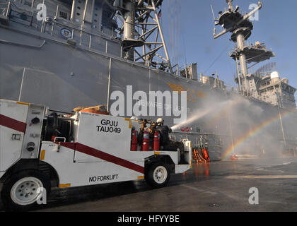 110723-N-KA046-014 MEDITERRANEAN SEA (July 23, 2011) Sailors use a P25 fire truck to wash down the superstructure - Stock Photo