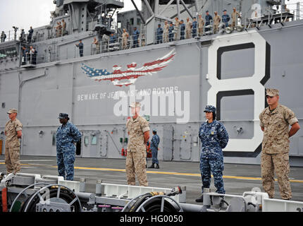110810-N-DX615-008 SAN DIEGO (Aug. 10, 2011) Sailors and Marines man the rails aboard the amphibious assault ship - Stock Photo