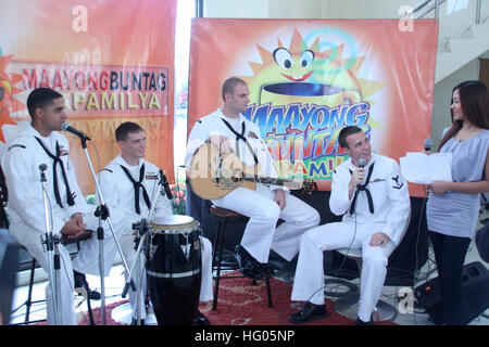 110919-N-FP123-256 CEBU CITY, Philippines (Sept. 19, 2011) The U.S. 7th Fleet Band, Orient Express, is interviewed - Stock Photo
