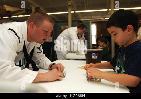 110928-N-BX435-009  MANCHESTER, N.H. (Sept. 28, 2011) Logistics Specialist 3rd Class John Hill, assigned to the - Stock Photo