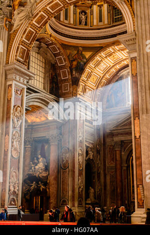 Sunbeams shining through a window into St. Peter's Basilica in Vatican city, Rome. - Stock Photo