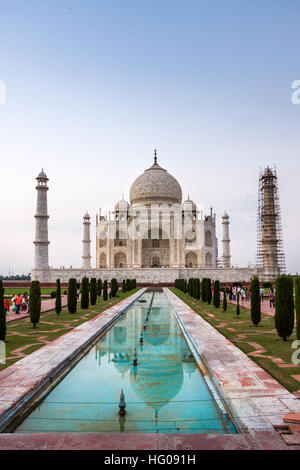 The reflex of Taj Mahal in the water in a hot summer afternoon. Agra, Uttar Pradesh. India - Stock Photo