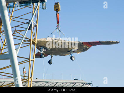 121126-N-GH675-004 NORFOLK (Nov. 26, 2012) Contractors hoist the X-47B Unmanned Combat Air System (UCAS) demonstrator - Stock Photo