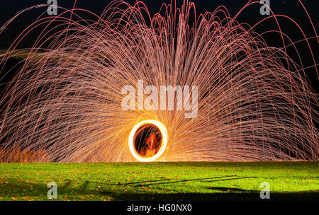Light painting with steel wool on fire - Stock Photo