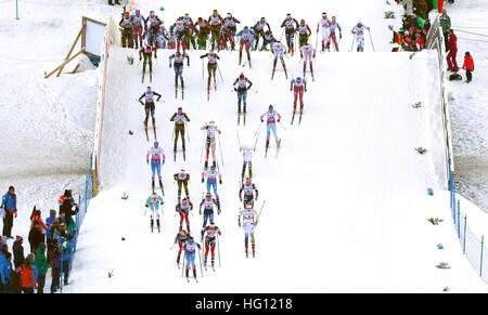 Oberstdorf, Germany. 03rd Jan, 2017. Cross-country skiers start in the FSI Tour de Ski competition in Oberstdorf, - Stock Photo