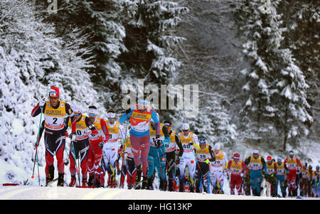 Oberstdorf, Germany. 03rd Jan, 2017. The Russian Sergey Ustiugov (M) leading the field during the FSI Tour de Ski - Stock Photo