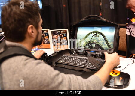 Las Vegas, Nevada, USA, 2nd January, 2017.  Attendee testing out Thrustmaster's new T.1600M FCS Flight Pack at Thrustmaster's - Stock Photo