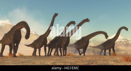 A Brachiosaurus dinosaur herd pass through a dry desert area in the Jurassic Period of North America. - Stock Photo