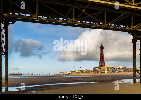 Blackpool Tower is pictured from under Central Pier, Blackpool, Lancashire, United Kingdom. - Stock Photo