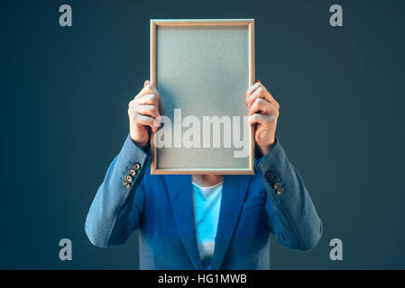 Business woman holding blank diploma certificate as copy space - Stock Photo