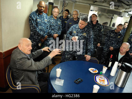 World War II veteran Sebastian Amato speaks with USS Ingraham Commanding Officer Cmdr. Daniel Straub and the ship's - Stock Photo