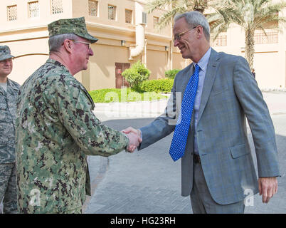 William V. Roebuck, United States Ambassador to the Kingdom of Bahrain, greets Vice Adm. John W. Miller, commander, - Stock Photo