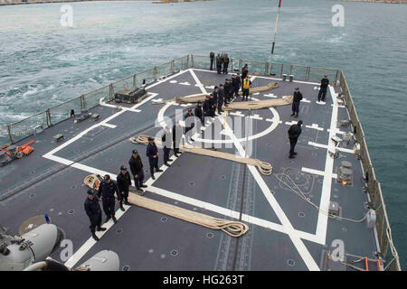 150401-N-VC236-047 PALMA DE MALLORCA, Spain (April 1, 2015) - Sailors stand in formation on the flight deck as the Arleigh Burke-class guided-missile destroyer USS Farragut (DDG 99) departs Palma de Mallorca, Spain, April 1, 2015. Farragut, homeported in Mayport, Fla., is conducting naval operations in the U.S. 6th Fleet area of operations in support of U.S. national security interests in Europe. (U.S. Navy photo by Mass Communication Specialist 3rd Class Jackie Hart/Released) USS Farragut departs Palma de Mallorca 150401-N-VC236-047