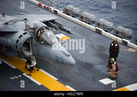 150604-N-DQ503-055    EAST CHINA SEA (June 4, 2015) – A Marine pilot prepares for take off in a AV-8B Harrier jet, - Stock Photo