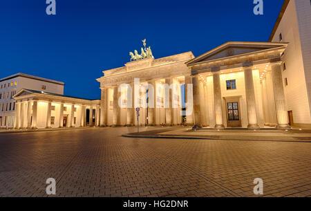 The famous Brandenburger Tor in Berlin illuminated at night - Stock Photo