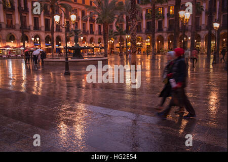 A group of young tourists stroll by the 'Plaza real' in Barcelona, Spain. The place near the Ramblas of Barcelon - Stock Photo