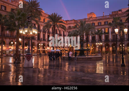 A group of young tourists stroll by the 'Plaza real' in Barcelona, Spain. The place near the Ramblas of Barcelona - Stock Photo