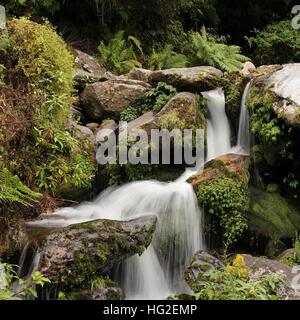 Water cascades on the way from Lukla to Namche Bazaar. - Stock Photo