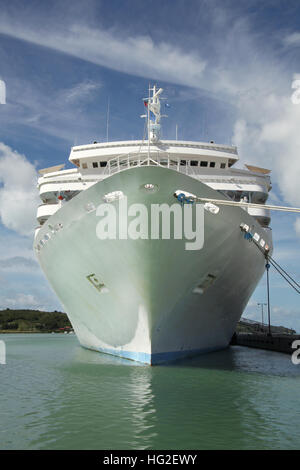 Large white cruise ship docked in the port with looking directly towards the ships bow, St John's, Antigua, Caribbean. - Stock Photo
