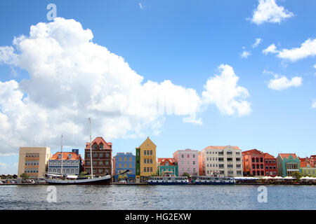 Waterfront of the Dutch Antilles town of Willemstad, with beautiful colorful buildings lining the waters edge, Curacao, - Stock Photo