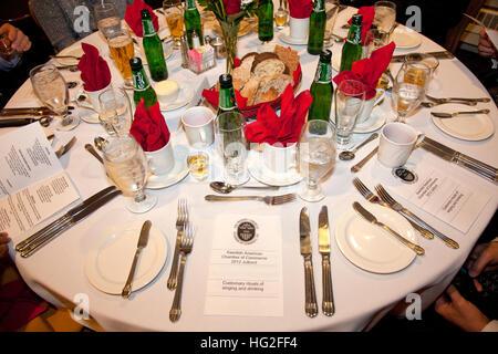 Beautiful dinner table setting at the annual Christmas Swedish Julbord festivities. Bloomington Minnesota MN USA - Stock Photo