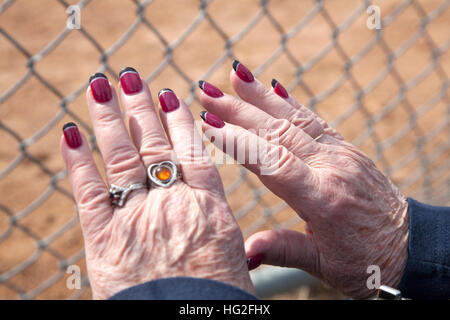Senior woman hands with red nails Stock Photo: 162520480 - Alamy