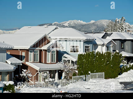 Snow covered homes and mountains in Greater Vancouver in December 2016. - Stock Photo