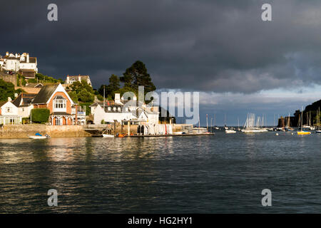 Kingswear under Dark Skies, View from the River Dart looking Towards the Sea and Dartmouth Castle, Devon. - Stock Photo