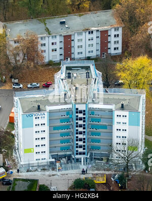 Aerial view, renovations VONOVIA skyscraper and settlement Narcissus Road, social housing, rental housing, Bochum, - Stock Photo
