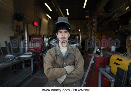 Portrait confident male welder in workshop doorway - Stock Photo