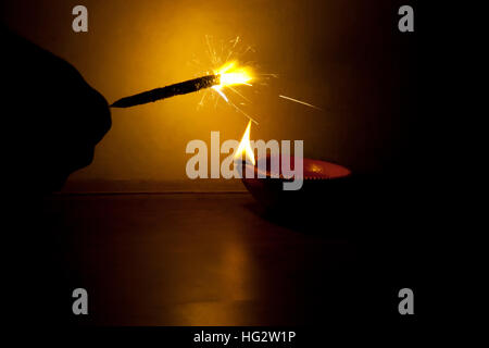 Person burning crackers on Diwali - Stock Photo