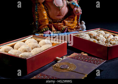 Sculpture of Ganesha with sweets , indian sweet - Stock Photo