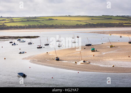 Moored boats at low tide on the River Camel at Rock in Cornwall, UK - Stock Photo