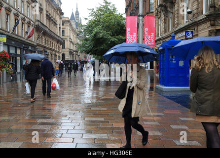 A rainy, summer's day on Buchanan Street, in Glasgow, Scotland, UK - Stock Photo